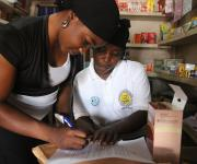 A patient Medicine provider (PMV), Salau Saidat Omotola(R) attends to a client, Aremu Bose after a family planning prescription in her outlet at Iwalesin district in Omuaran township in Nigeria's central state of Kwara, November 5, 2012.