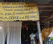 A signboard is seen in front of a local restaurant in Iwalesin district in Omuaran township in Nigeria's central state of Kwara, November 5, 2012.