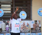 A mobilizer adjusts a dangler promoting family planning before a mobility parade at Orolodo primary health centre in Omuaran township in Nigeria's central state of Kwara, November 5, 2012.