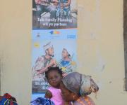 A woman, Oluwatosin Idowu plays with her daughter as she waits a doctor outside the ante natal unit at Orolodo primary health centre in Omuaran township in Nigeria's central state of Kwara, November 5, 2012.