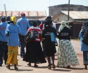 Family planning mobilizers walk through a street during a visibility parade in Omuaran in Nigeria's central state of Kwara, November 5, 2012.