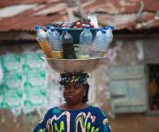 A woman hawks local herbal medicine in plastic bottles along a street in Oniyanrin community in Ibadan, South-west, Nigeria, November 7, 2012
