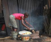 A woman fries yam along a street in Ibadan, South-west, Nigeria, November 7, 2012.