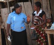A family planning mobilizer canvasses a client, Edith Thomas at Romi market during a family planning mobilization campaign in Nigeria's northern city of Kaduna, November  12, 2012.