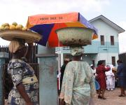 Two women hawking stand near an umbrella promoting family planning during a visibility parade in Oniyanrin primary health centre in Ibadan, South-west, Nigeria November 7, 2012.