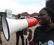 A mobilizer uses public address system to promote family planning during a visibility parade in Oniyanrin primary health centre in Ibadan, South-west, Nigeria November 7, 2012