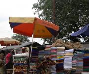 An umbrella campaigning family planning is spotted at a roadside market in Mapo district in Ibadan, South-west, Nigeria November 7, 2012.