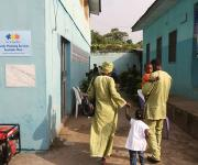 A couple, Mr and Mrs Taiwo Gabreal walk into Molete district primary health centre with their children for a family planning counselling session in Ibadan, South-west, Nigeria, November 7, 2012.