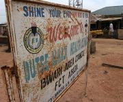 A signboard is seen outside the Dutse Alhaji primary health care centre in Bwari district, outskirt of Nigeria's capital Abuja November 9, 2012.