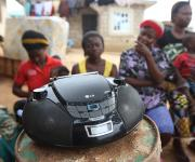 A radio is placed on a drum as a radio listeners' group sit around it in Mpape village in the outskirt of Nigeria's capital Abuja November 9, 2012.