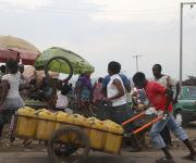 A man pushes a cart past a market at a slum in Mpape village in the outskirt of Nigeria's capital Abuja November 9, 2012.