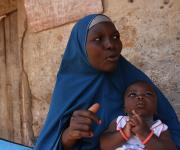 Zainab Allassan, a family planning user, describes her satisfaction during a visit of the NURHI advocacy team, outside her home in Jiwa village, outskirt of Nigeria's capital Abuja November 10, 2012.