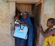 Zainab Allassan, a family planning user, steps outside her house during a visit of the NURHI advocacy team, in Jiwa village, outskirt of Nigeria's capital Abuja November 10, 2012.