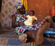 Ramatu Isah, a family planning user, plays with her baby during a visit of the NURHI advocacy team, outside her home in Jiwa village, outskirt of Nigeria's capital Abuja November 10, 2012.