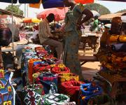 Fabrics are displayed for sales in a market in Kakuri district in Nigeria's northern city of Kaduna, November 12, 2012.
