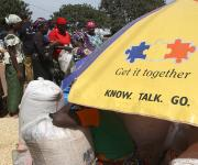 Foodstuffs are displayed for sale in a market under a NURHI designed umbrella used for promoting family planning in Kakuri district in Nigeria's northern city of Kaduna, November 12, 2012.