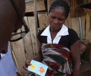 A family planning client, Edith Thomas holds a Go referral card at Romi market during a family planning mobilization campaign in Nigeria's northern city of Kaduna, November  12, 2012.