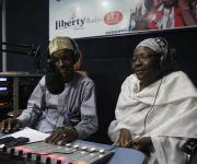 A radio anchor, Usman kabara discusses with a family planning expert Habiba Ahmed Abdulkareem during a live programme tagged on faily planning on Liberty FM in Nigeria's northern city of Kaduna, November  12, 2012.