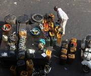 A man sells used oil in containers at Kawo motor park in Nigeria's northern city of Kaduna, November  13, 2012.
