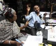 A radio anchor Oche discusses with a family planning expert, Mariam Momoh during a live programme on family planning on Wazobia FM in Abuja, .November 15, 2012.