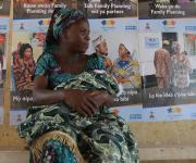 A woman, Funmilayo Ogundipe wraps her baby with cloth as she waits for the opening of ante natal session at Orolodo primary health centre in Omuaran township in Nigeria's central state of Kwara, November 5, 2012.