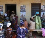 Nursing mothers wait at outside the ante natal unit at Orolodo primary health centre before the start of a family planning visibility parade in Omuaran township in Nigeria's central state of Kwara, November 5, 2012.