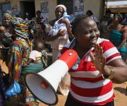 A family planning mobilizer sings with nursing mothers at the start of a family planning visibility parade in Omuaran township in Nigeria's central state of Kwara, November 5, 2012.