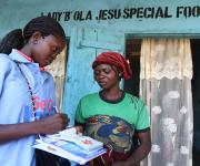 A woman, Ruth Adebayo, is referred  by a family planning mobilizer during a visibility parade near Orolodo primary health centre in Omuaran township in Nigeria's central state of Kwara, November 5, 2012.