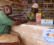 A patient medicine vendor, Chief Stephen-Kola Adewunmi(R) counsels a client, Lasisi Iyanda Hamed, in his shop on Taiwo road in Orolodo neighbourhood in Omuaran township in Nigeria's central state of Kwara, November 5, 2012.