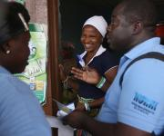 Family planning mobilizers speak to a client, Tope Olawuyi (C)during a visibility parade near Orolodo primary health centre in Omuaran township in Nigeria's central state of Kwara, November 5, 2012.