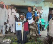 Graduate receives NURHI gift at Trade Apprentice Graduation at Shao Garage in Ilorin